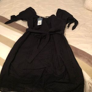 Adorable black cap sleeve belted black dress!